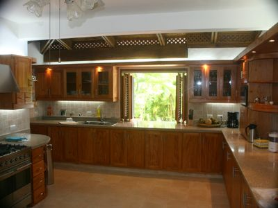 Kitchen with window to pool terrace