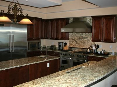 Fully Equipped Kitchen With Granite Countertops And Viking Appliances