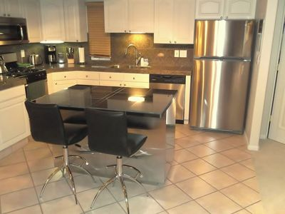 Recently added stainless steel kitchen island for your family gatherings.