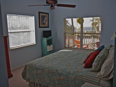.Sunny master bedroom with views over Tampa Bay