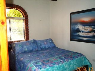 Las Gaviotas house photo - The downstairs bedroom in the one bedroom apartment. It is a queen bed.