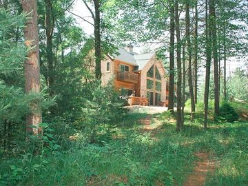Arkdale house rental - Wooded Trail View of Vacation Home from Lake. Approximate walk of 120-150 feet