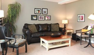 Nashville townhome photo - Your Living Room Downstairs is Filled With Regional Art, Games, and Books