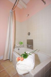 Full bath/tub and shower, tile floor.  Specialty shampoos and luxury towels.