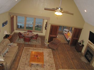 Great room, dining and sun porch from loft