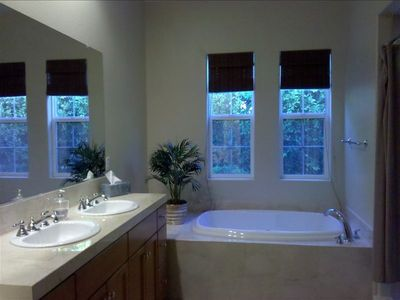 MASTER BATHROOM HAS A VANITY FOR THE LADIES TO GET READY TO HIT THE TOWN...