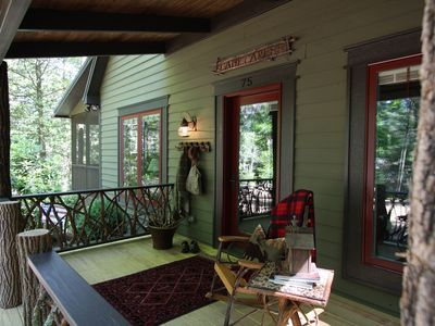 Relax with a cup of coffee from your front porch nestled in the woods.