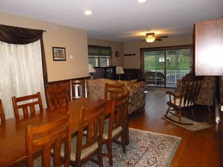 Jefferson farmhouse photo - Dining room/living room w/ TV,sliding doors lead to deck with view of the pond.