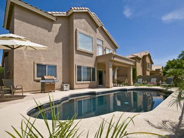 Phoenix house rental - Heated Pebble Tec swimming pool in south-facing backyard.