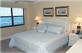 Master Bedroom with Direct Ocean Views and Access to Private Balcony