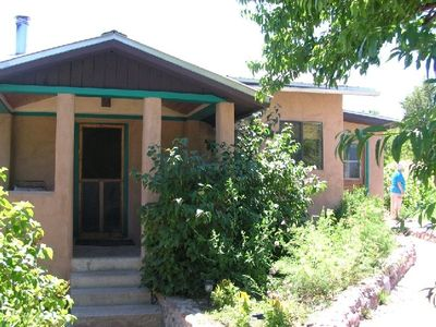 Casita amidst flower and vegetable gardens and fruit trees