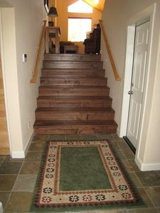 Hardwood floor entryway to cozy family room and gourmet kitchen.