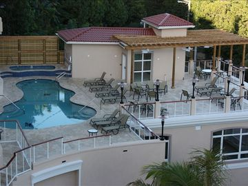 View of pool, hot tub and sun deck from your balcony