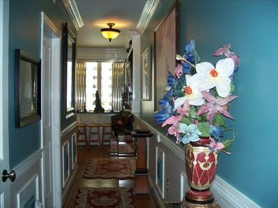 Hallway with custom crown molding, wall artwork. Gulfview bar/2 stools
