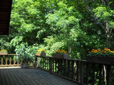 Expansive deck offers privacy with beautiful views on three sides.