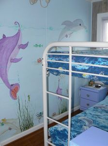 Bunk bed room w/hand painted mural located on 2nd level