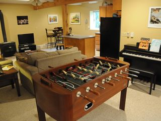Swanton house photo - Foos Ball table in Den with Xbox, DVD/VCR and movie library, new Yamaha piano