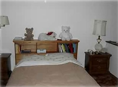 Comfortable bed, additional clean sheets in drawer below bed.