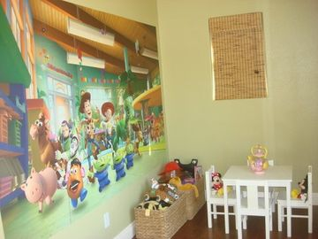 Play room with LOTS of toys and a fun Toy Story mural!