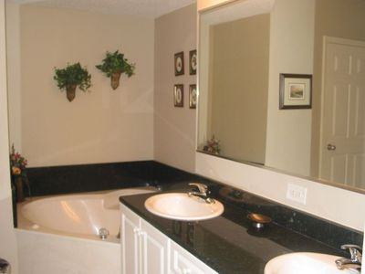 Master Bath w/ jetted tub, separate large, glass shower and double sinks