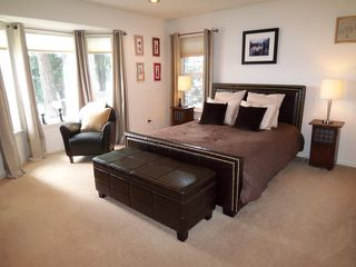 Shelton house photo - Master bedroom with water views, queen bed, TV/DVD, en suite bathroom, jet tub.