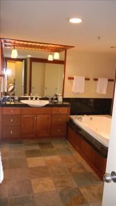 Another view of the very spacious bath area with a large Jacuzzi tub.