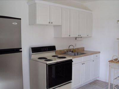 #2: Open kitchen is furnished and provides plenty of storage.