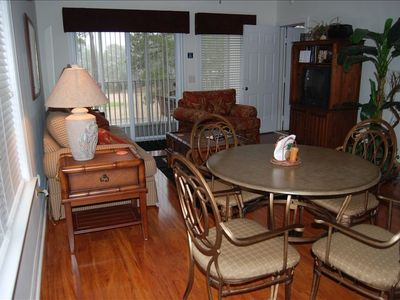 View of dining table and living room.  And on other side of TV, connecting door
