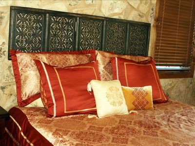 master bedroom with king-size bed, other bedrooms have queen-size beds