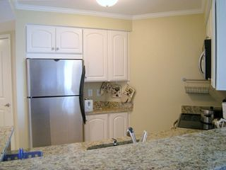 Full Kitchen Open to Living Room and View of the Bay