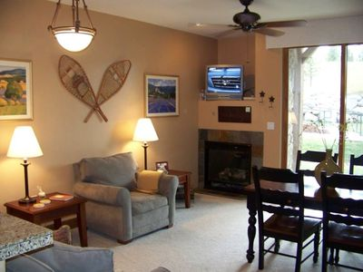 Cozy living room, fireplace, dining area - all the comforts of home!