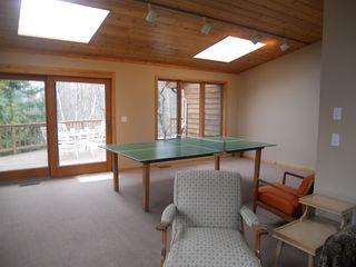 Jacksonport house photo - Rec Room has 3 sky lites, ping pong table and Large Screen TV.