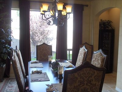 Formal dining room. Table seats 8 comfortably. Wine storage and bar niche.