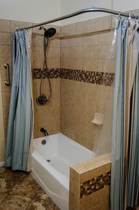 Master bathrooms tub/shower combination.