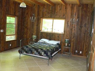 Phoenicia house photo - Bedroom one with screened in porch and balcony with view of stream.