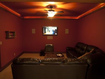"Theater room with 42"" plasma, DVD, surround sound and a double hide-a-bed."