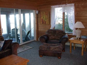 View of Living Room into Screened in porch
