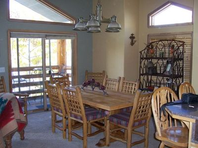 Dining room looking toward front balcony and mountian view