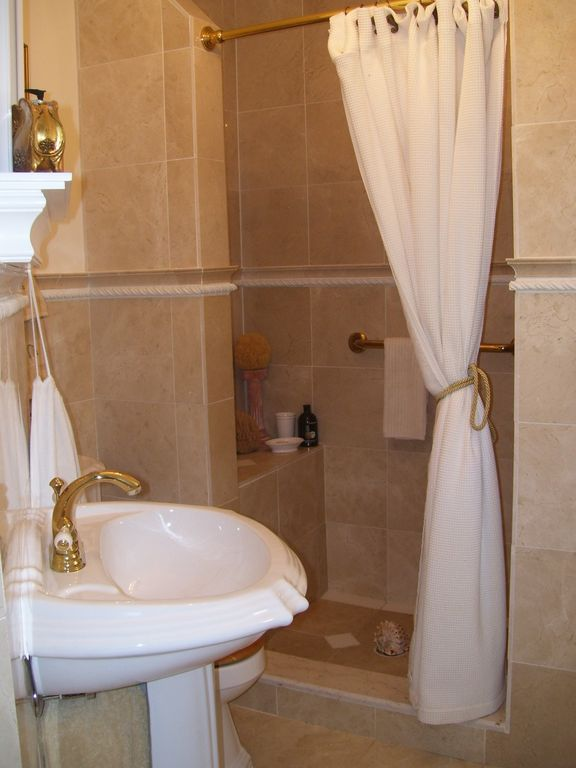 Marble bathroom on first floor with walk-in shower