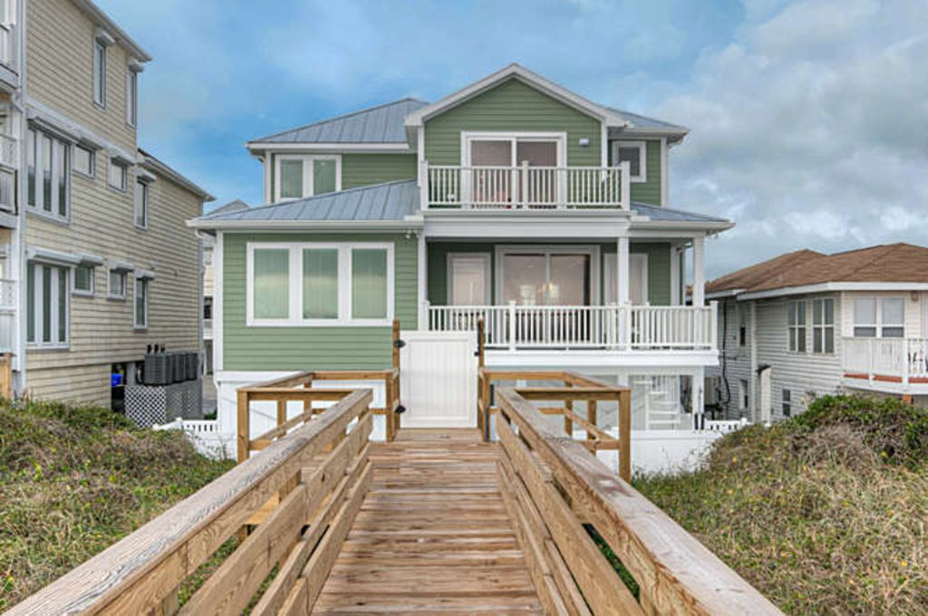 Sage seahorse carolina beach home pool elevator for Beach house elevator cost