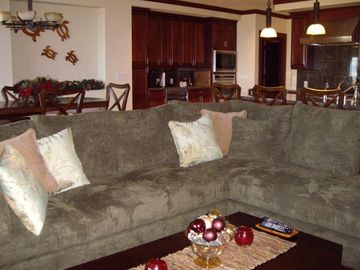 Relax in our living room overlooking the private pool, lanai, and ocean