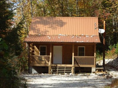 Fall 2010:  Lillie's Cub Cabin with Autum leaves in fall colors in background.
