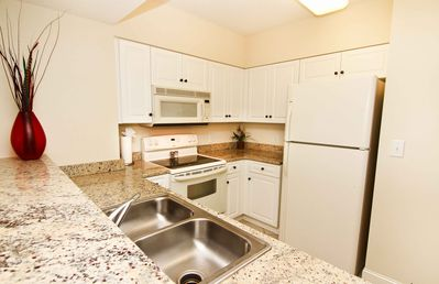 South Wind condo rental - FULLY EQUIPPED KITCHEN WITH GRANITE COUNTERTOPS