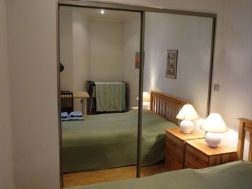 Second Bedroom; Queen Bed: Huge Storage closet behind Mirrors for your luggage!