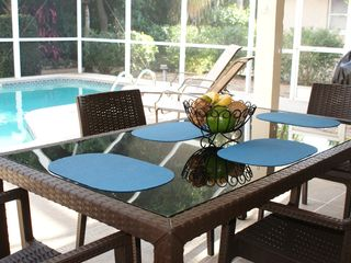Vacation Homes in Marco Island house photo - Dining al fresco is the ideal vacation meal. Grill your favorite dish and enjoy!