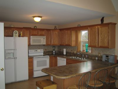 Large kitchen w Breakfast nook for four. Fully stocked kitchen,pots ,dishes ect