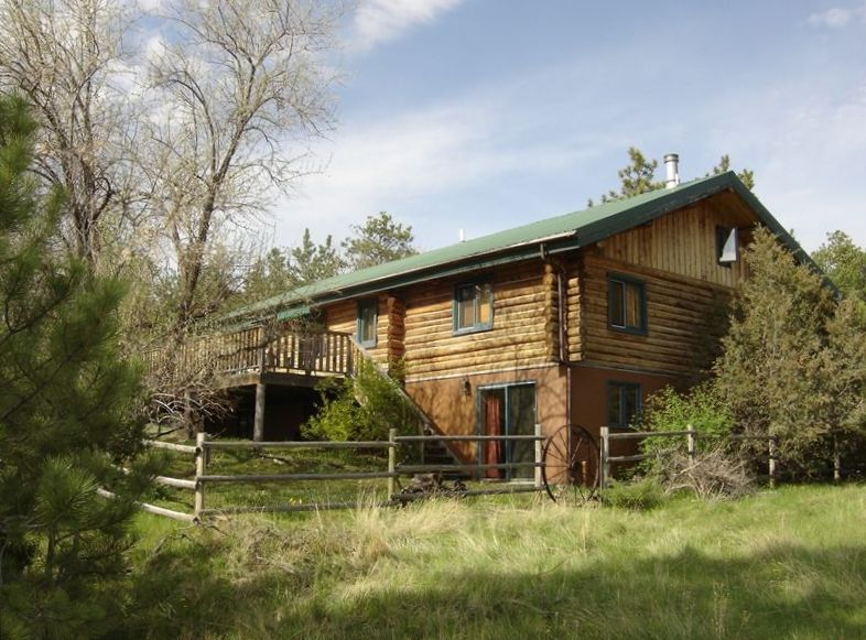 Log cabin on a ranch in the bull mountains 4 br vacation for Vacation log homes