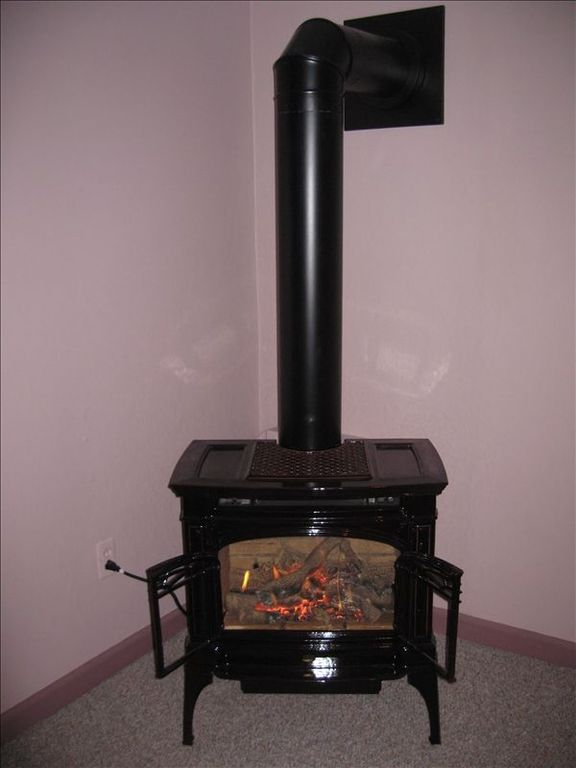 New gas stove in living/dining room, beautiful for off-season