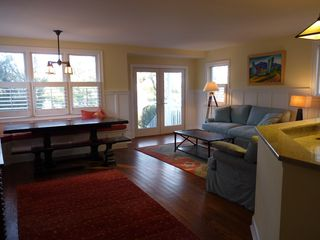 Rehoboth Beach house photo - Reverse view of kitchen with dining table, lake view out windows