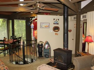 Big Canoe house photo - View of Fireplace and Dining Table